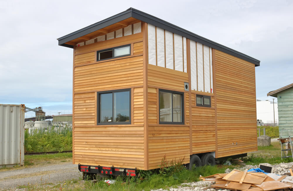 Should tiny homes have a foundation or stay on wheels?