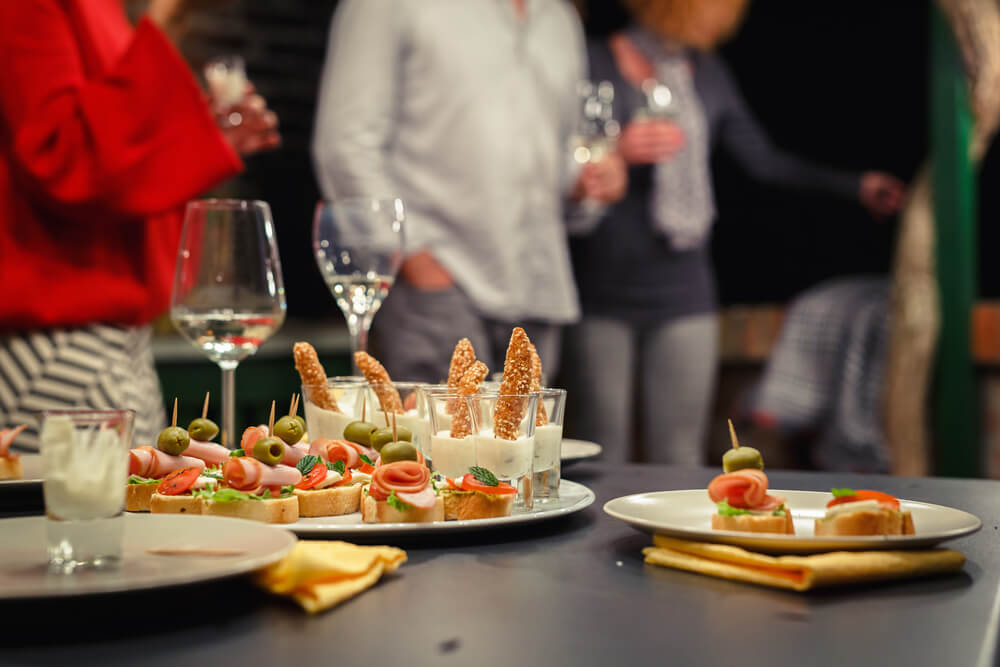 finger foods and guests in a party