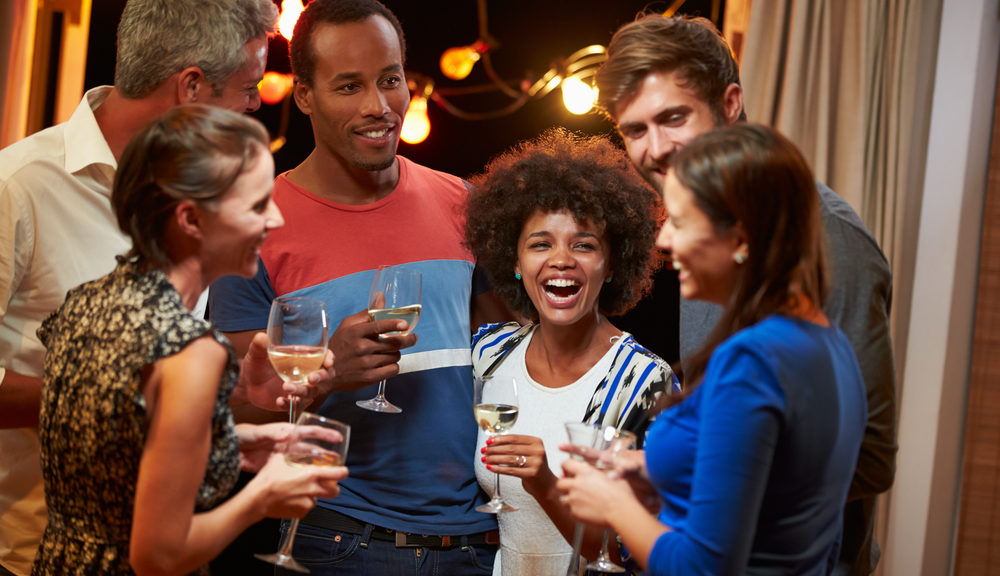 party guests laughing with each other