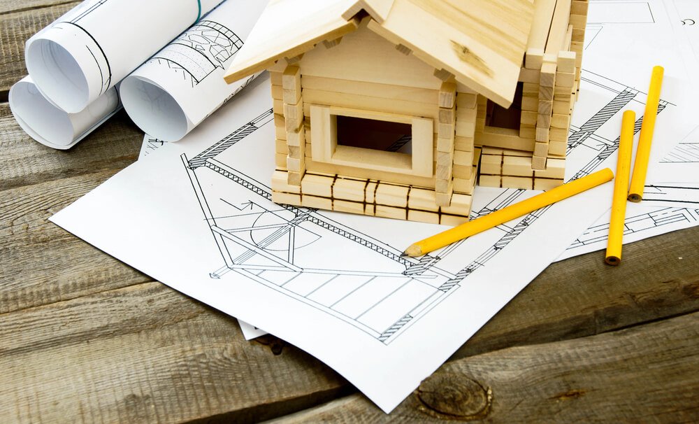 house plans with a miniature house and pencils
