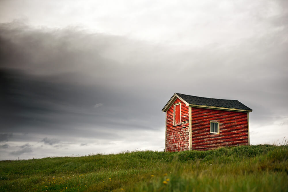 tiny home safety - a dark cloud looms over a tiny house