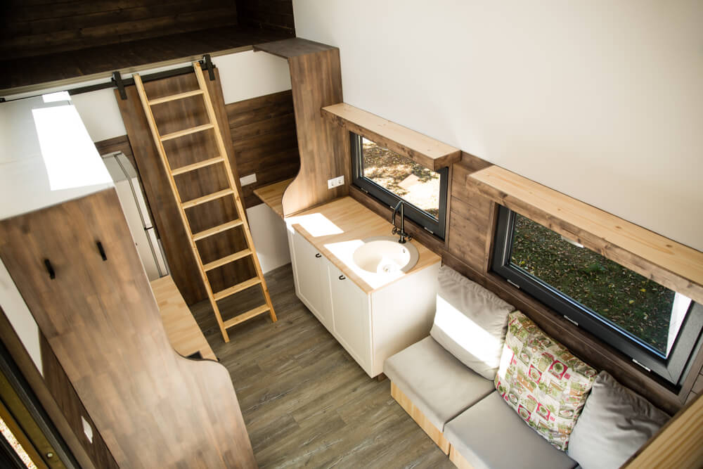 live big in a tiny living space - tiny house interior with brown and white hues