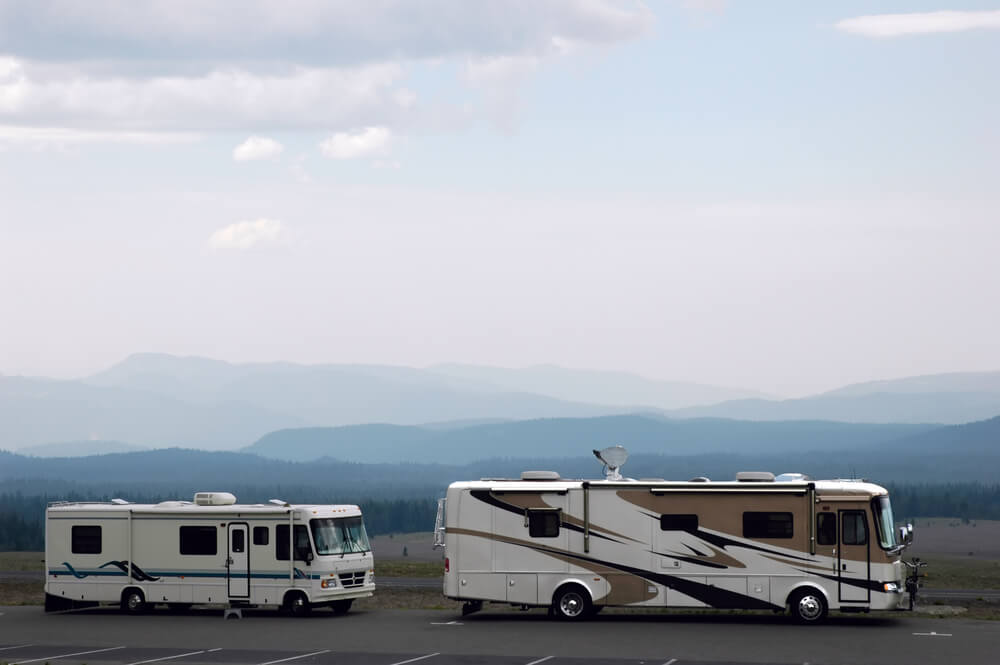 two white RVs on the mountains