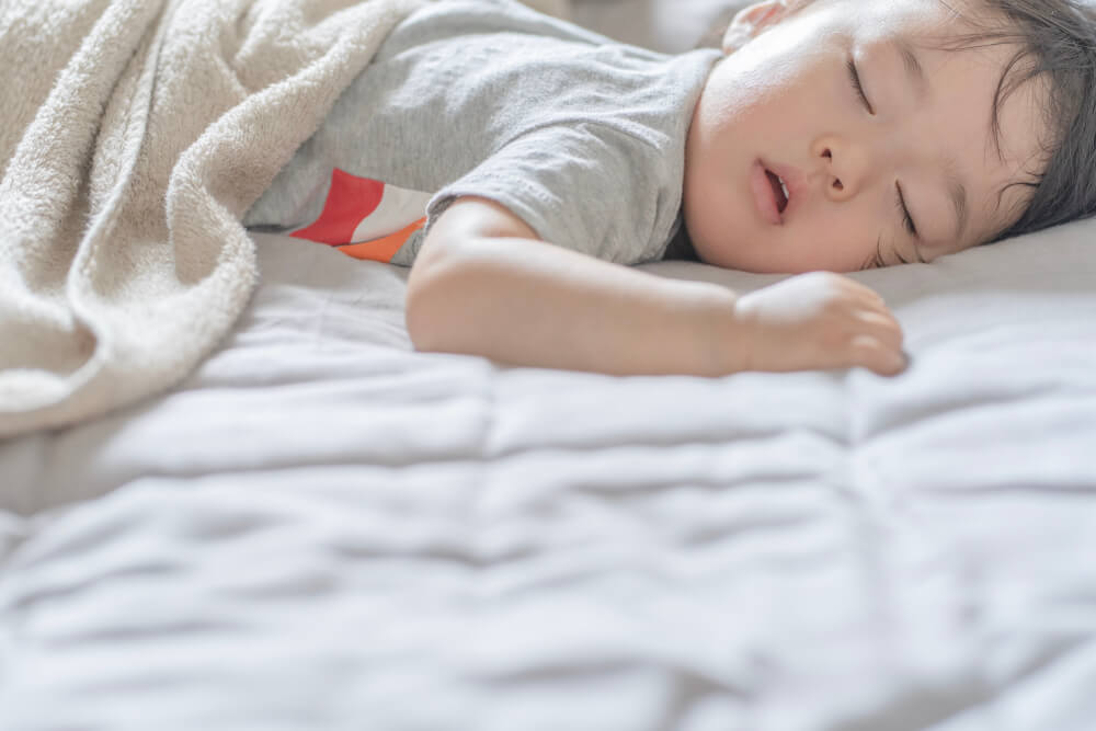 why critics don't like tiny houses - a kid sleeping on a white bed