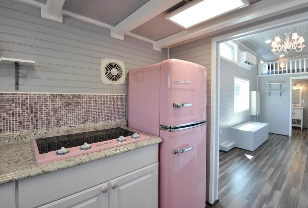 pink fridge and pink electric stove. beige kitchen. white trimmings.